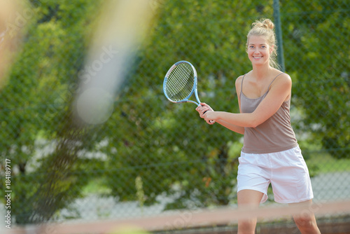playing outdoor tennis