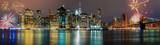 Brightly colorful fireworksNew York City manhattan buildings skyline night evening - 184197923
