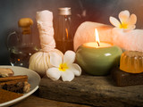 Spa massage items,aroma oil,herbal compress ball,soap  and towel in candlelight. - 184198116