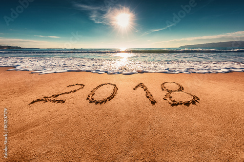 Foto auf Acrylglas See sonnenuntergang Happy New Year 2018 concept on the sea beach; sunrsie shot