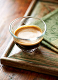 Glass of espresso on old wooden frame - 184216109