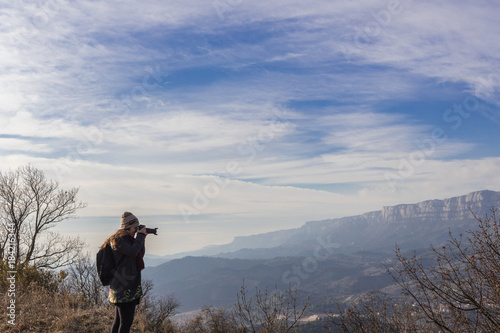 Wall mural Woman photographing surreal landscape high in the mountains of Siurana, Spain