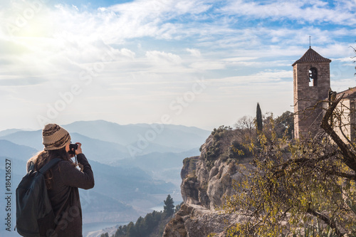 Staande foto Cappuccino Woman photographing surreal landscape high in the mountains of Siurana, Spain