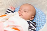 Eurasian baby sleeping in his cradle