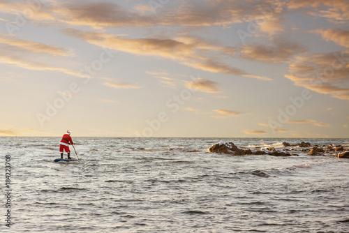 Fototapeta Santa on SUP board