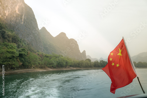 Poster Guilin Li River Cruise through Karst Mountains in Guilin China with Chinese Flag Flying in Foreground
