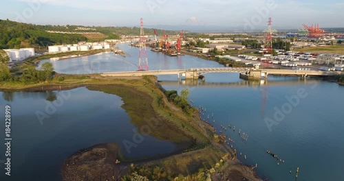 Wall mural Tacoma Industrial Area Aerial Flying Over Birds Bridge Mt Rainier