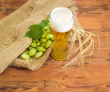 Glass of beer, hop cones and barley ears - 184241167