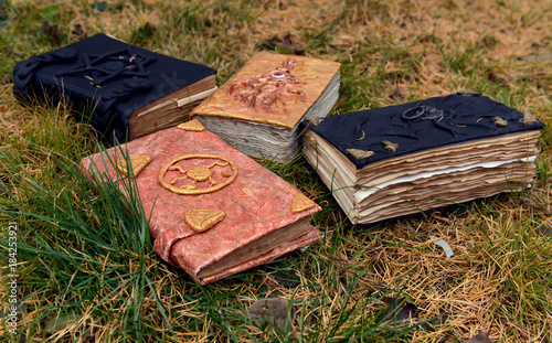Old magic books on grass background  Occult, esoteric