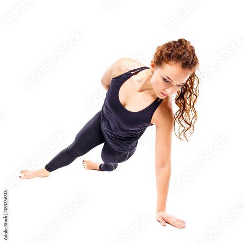 Poster Young fit woman doing pilates excercises isolated on white background