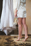 White wedding dress and bride with shoes
