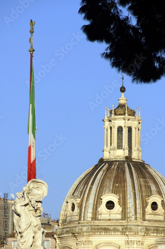 Foto op Canvas Rome Rome (Italy). Flag of the Republic of Italy with the dome of Santa Maria di Loreto in Rome