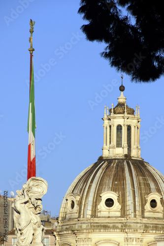 Tuinposter Rome Rome (Italy). Flag of the Republic of Italy with the dome of Santa Maria di Loreto in Rome
