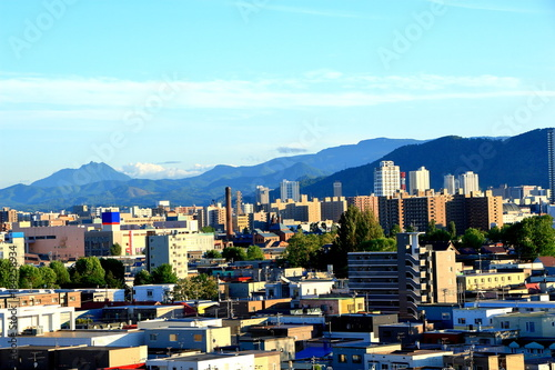 Deurstickers Lichtblauw View of mountain ranges from the city of Sapporo