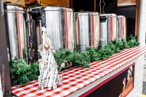 Thermos tanks for the sale of hot drinks punch and mulled wine and food at the Christmas Fair