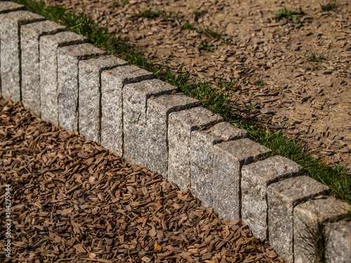 Tuinposter Baksteen muur Pallisaden aus Granit