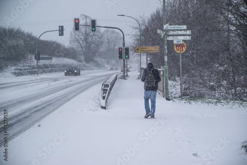 Foto op Plexiglas New York TAXI a man walking on a road in heavy snow , Germany, Hesse 2017