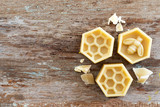 natural yellow beeswax on wooden background. - 184280577
