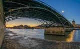 River Seine with Pont des Arts and Institut de France at sunrise in Paris