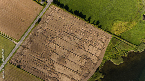 Aerial view of field and water