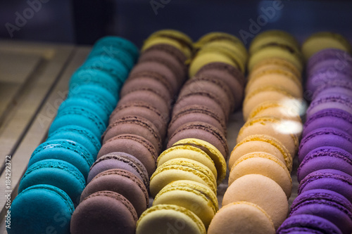 Fotobehang Macarons beautiful and tasty multi colored macarons under the shop window of the bakery confectionery shop