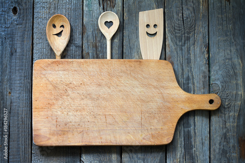 Old retro vitnage empty cutting board fun food concept background with spoon