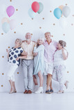 Senior friends with colorful balloons - 184297112