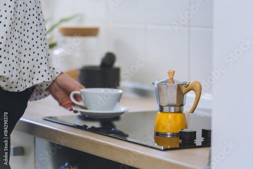 Pregnant woman making mocha espresso coffee