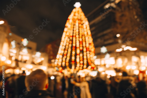 Christmas tree in the town square. Blurred background of the Christmas tree