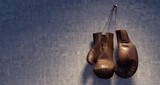 Brown leather boxing gloves hanging on grungy concrete wall 3D Rendering - 184303980