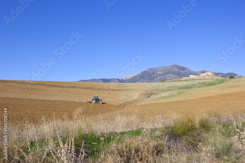 Foto op Canvas Natuur spanish farmland with tractor