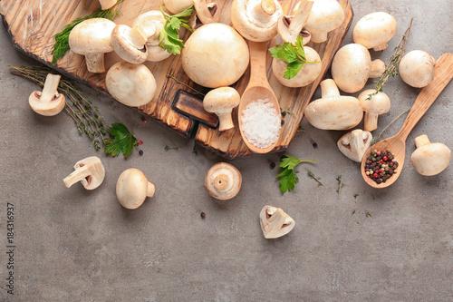 Fotobehang Kruiden 2 Fresh champignon mushrooms on table