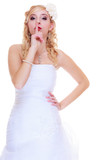 Bride in white wedding dress showing silence sign - 184317798
