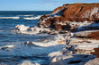 Winter waves roll in along the shoreline of rural Prince Edward Island, Canada.