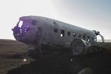 Carcass of airplane on the black beach