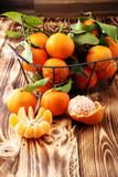 fresh mandarin oranges fruit with leaves in basket