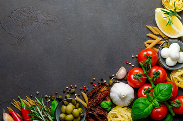 Italian food on a dark background with copy space, ingredients f