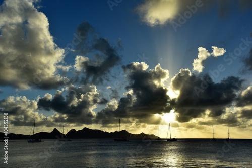 Deurstickers Ochtendgloren Landscape of paradise tropical island beach, sunrise shot. Spectacular clouds and sun beams.