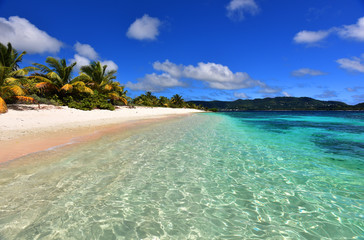 Tropical white sand beach with palm trees. Romantic atoll island paradise luxury resort.