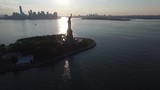Picturesque aerial drone view on national symbol United States America statue of Liberty on lonely island ocean sunset - 184353908