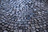 old cobblestone street dark night background texture