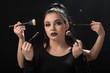 Two beautiful girls doing makeup