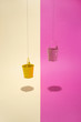 Pink and yellow bucket on a colored background - 184377564