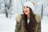 Attractive young woman in wintertime outdoor - 184385396