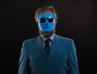 portrait of a man in a blue suit and a blue mask