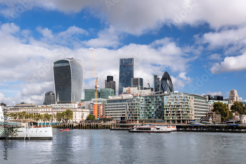 London with modern city architecture against river with boats in England, UK