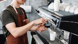 Barista. Hand making the coffee closeup - 184404577