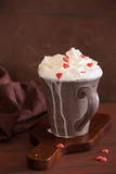 cup of coffee with whipped cream and red hearts - 184420526