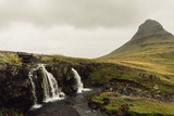 amazing landscape with majestic scenic waterfall in Iceland