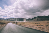 empty asphalt road in mountain valley and cloudy sky in Indian Himalayas, Ladakh region